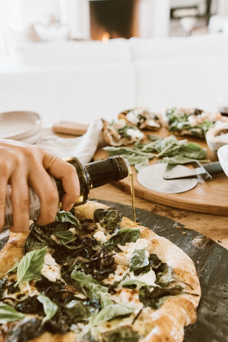 Camille Styles spinach and ricotta homemade pizza recipe baked in oven on pizza stone