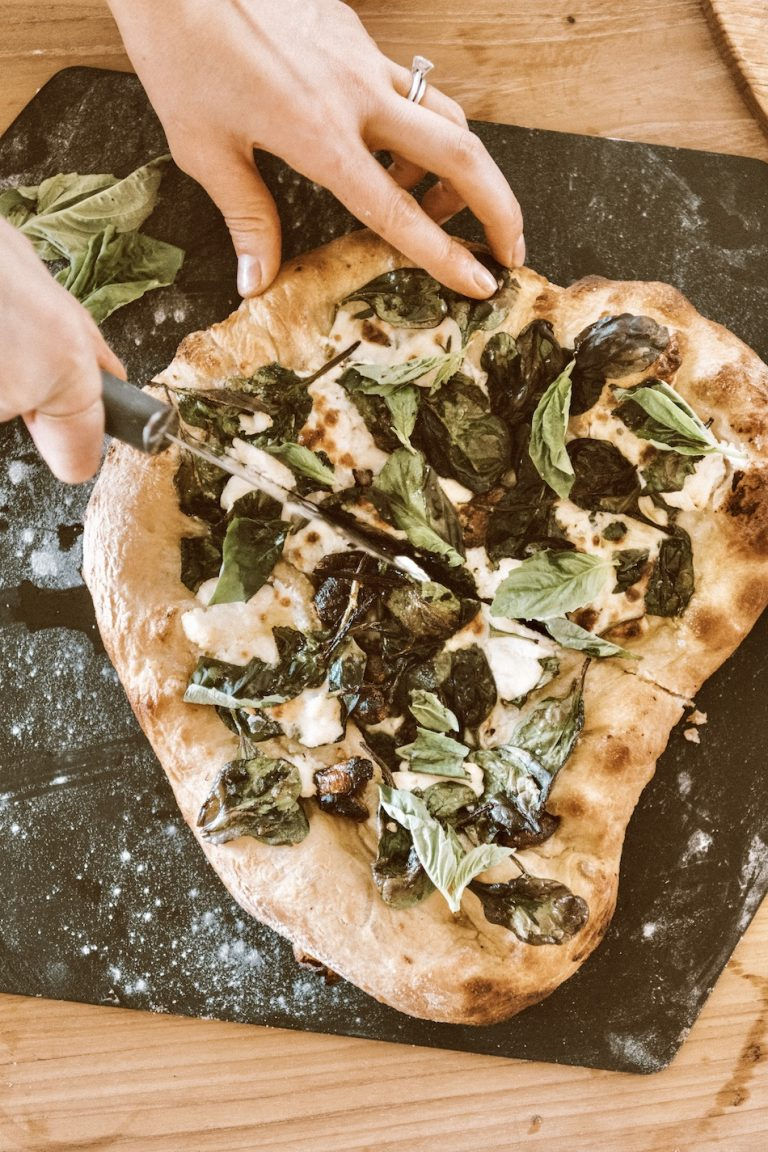 Camille Styles spinach ricotta homemade pizza recipe baked in oven on pizza stone