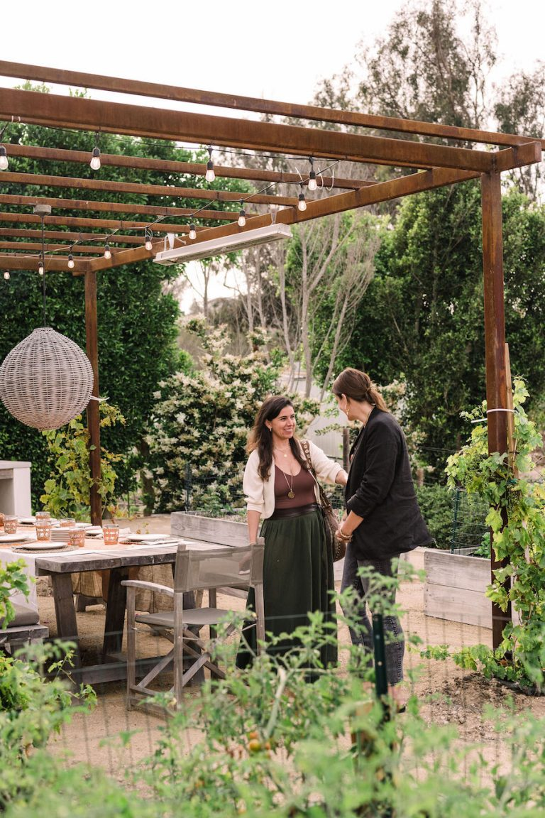 summer dinner party - beautiful backyard at sunset with covered terrace and pizza oven - helene henderson home - malibu farm