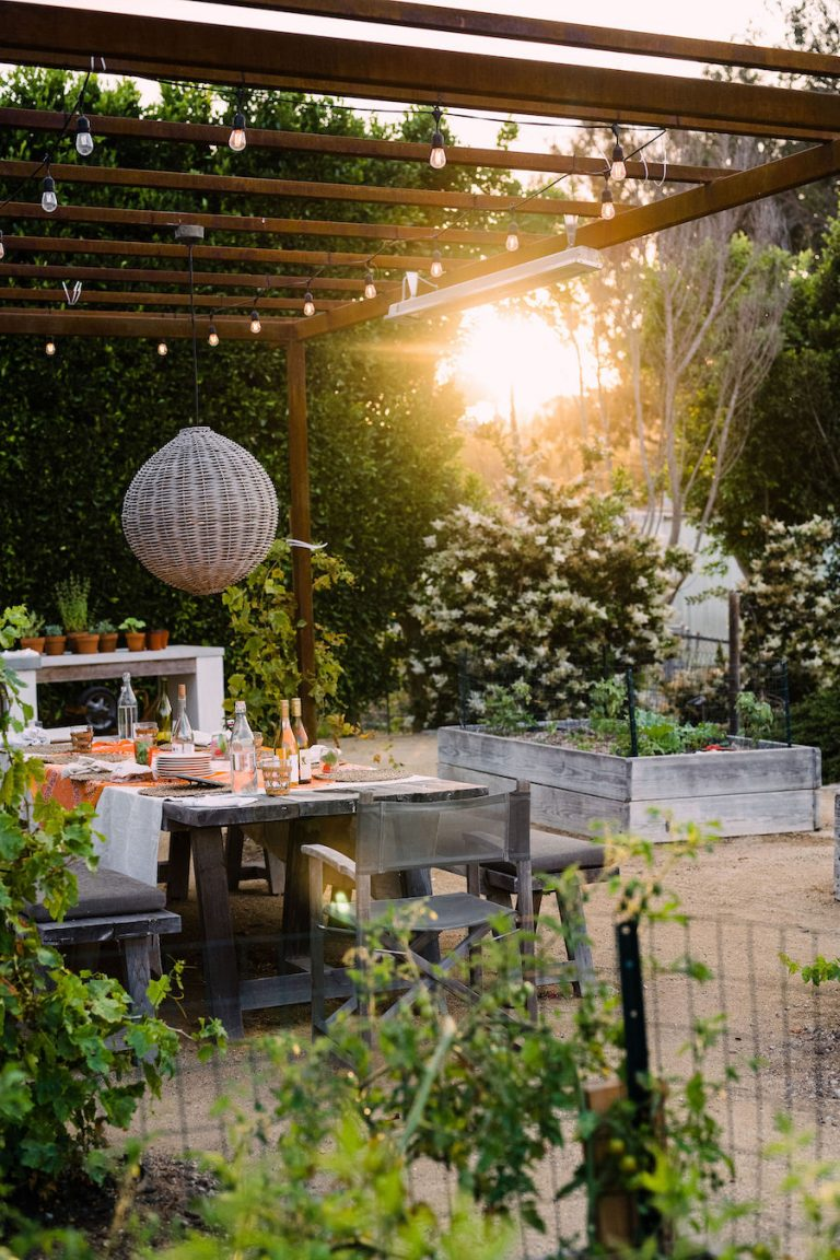 beautiful backyard at sunset with covered terrace and pizza oven - helene henderson home - malibu farm