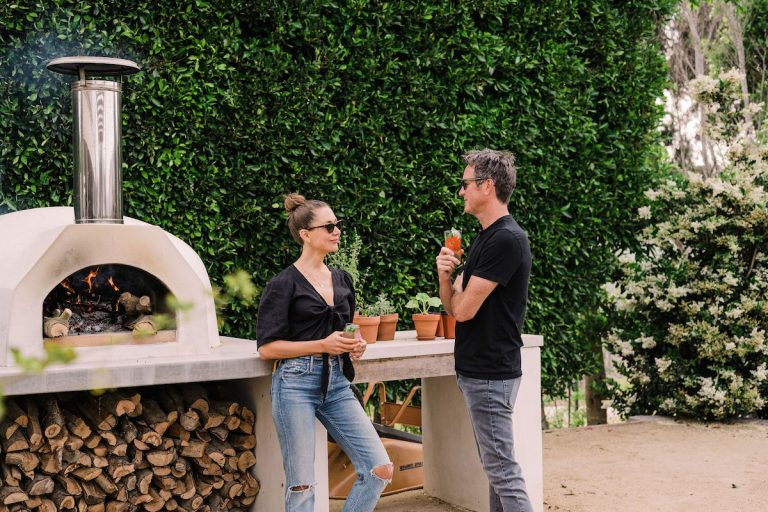 beautiful backyard at sunset with covered terrace and pizza oven - helene henderson home - malibu farm - couple - camille and adam - date - romance